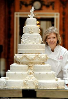 Fiona Cairns stands proudly next to the Royal Wedding cake that she and her team made for ...