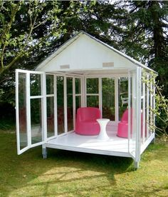 What a neat idea. . repurpose old windows and make a nice outdoor seating area. .