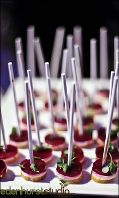 Goat Cheese and Beet Lollipop at an event by Blue Plate Catering in Chicago
