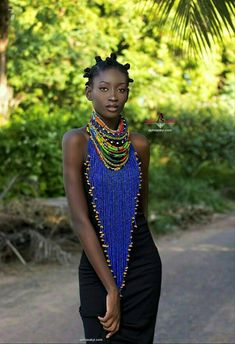 This African necklace named LEBENE is made with carefully selected African prints, and beads , perfect for a gift , not very heavy and comfortable to wear due the fabric around the neck .. But this while you can ...