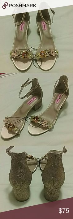 NEW Betsey Johnson heels Brand new Betsey Johnson strappy heels. Silverish gold with 3D flower embezzle across the front straps with little diamonds and beaded gems in the middle of the flowers back of the heels and the straps are silver gold glitter. These heels are a must have. NEW NEW NEW! ! ! MAKE A OFFER! ! ! Betsey Johnson Shoes Heels