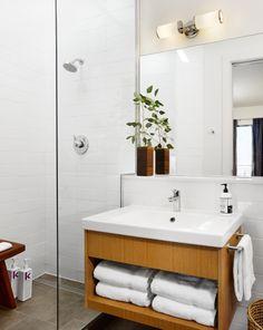 Nice clean crisp look for a bathroom. #showerdoor #whitebathroom Heywood Hotel, Austin, Texas