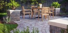Utilizing a wall in your patio design can create a cozy table area or a grand entrance. #BelAirWall #DublinPaver
