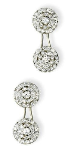 A PAIR OF ART DECO DIAMOND CUFFLINKS, BY VAN CLEEF & ARPELS   Each circular openwork panel of floral design set with old and single-cut diamonds, to the plain gold link bar, mounted in platinum and gold, made in 1926, with French assay marks for gold  Signed Van Cleef & Arpels, nos. 28384 and 28385