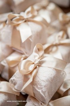 wrapped in tissue, lace and tied with sumptuous satin bows...