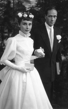 Audrey Hepburn from Celeb Wedding Dresses  The brunette beauty's first wedding dress (worn to marry Mel Ferrer in 1954) was a tea-length, white organdie design by French couturier Pierre Balmain. (The frock may be the most chic, and certainly most iconic, short wedding dress ever worn.)