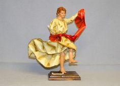 """""""Pizzica"""" dancer of Arte Sacra di Claudio Riso Papier-mache statuette with terracotta limbs and wooden base, painted in oil with colors that reflect those of the traditional clothes."""