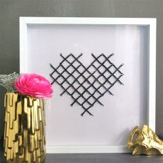 Easy cross stitch art for Valentine's Day I like the idea for an ever changing cross stich shadow box. I can do a different cross stitch to match the occasion's corner !