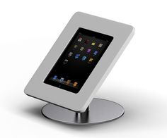 Apple iPad stand. Stainless steel frame with dupont corian ipad holder    more at www.pro-ipad-stand.com     :) i love my ipad. Check out my website for some ipad tips.