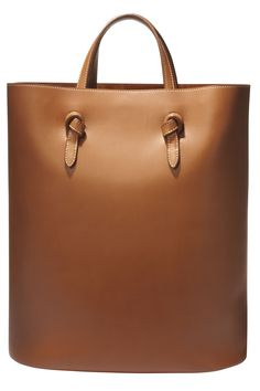 6) 7) The long and lean tote has it in the bag