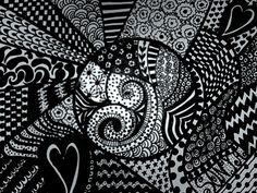 So what is Zentangle?  Zentangle is really just a fancy, contained doodle.  This fun art form is a method to make beautiful images using repetitive patterns.  It's easy to learn, simple, relaxing, and very addicting!!