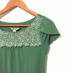 "Anthro Green Floral Punch-out Tee by Ric Rac With tulip sleeves and a punched out embroidered floral yoke this spring tee is sure to inspire smiles. Easy to dress up or down thanks to the special details that elevate it from a simple tee. Size S and close fitting. In EUC.  Bust: 31"" Waist: 29"" Hem: 35"" Length: 23""  If you have any questions or would like additional pics/measurements I'd be delighted to help. 😊 No PP or trades, please make single item offers with the offer button, bundle…"