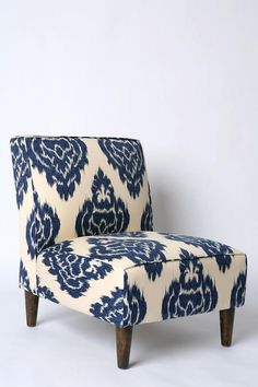 In my next home, my living room will be navy blue just so I can get this chair.