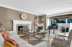 House Crush. Love the pops of color on the sofa and how Louis XV style armchairs have been given a twist with a more contemporary fabric!