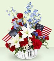 Time to decorate for those red, white and blue holidays! This basket of white Asiatic lilies, blue belladonna, and red carnations is sure to add a festive touch to your home.    $49.95