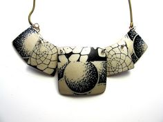 Creative Corbieres by Debbie Anne, via Flickr Necklace from Louise Fischer Cozzi's workshop, Image transfer.