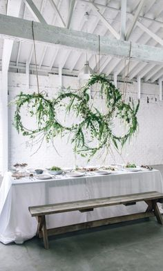 8 Creative Ways to Incorporate Greenery Wreaths Into Your Wedding Day