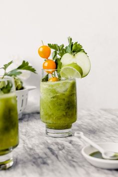 These green bloody marys are a refreshing take on the classic brunch cocktail. Made with tomatillos, yellow tomatoes, tart green apple, jalapeno and fresh herbs, they're smooth, fresh, slightly sweet and just a bit spicy. | from Lauren Grant of Zestful Kitchen #bloodymaryrecipe #brunchcocktail #greencocktail