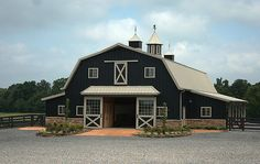 Farm History | Deeply Rooted Farms Black siding gambrel roof by Morton Buildings