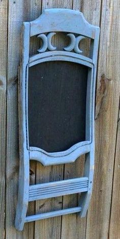 Chalkboard with towel bar made from old wooden chair back and repurposed wood…