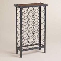 Handsome and modern, this exclusive Maison 28-Bottle Floor Wine Rack features an industrial metal frame with warm distressed wood top. Sturdy and spacious, it holds twenty-eight bottles of wine or champagne.