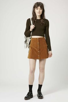 My craving for a tan corduroy skirt seems to only be getting worse over time.....so 70's I love it!