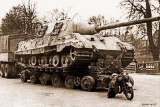 British forces capture a German Jagdtiger with Porsche suspension. It's being transported on a 80 ton Culemeyer R80 trailer to England. It now lies in their present day tank museum.