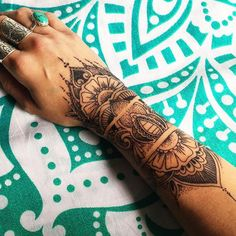 henna inspired tattoo wrist , absolutely love this