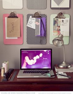 clipboards mounted on the wall - great way to organize papers, invites and mail!