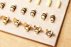 Buttercream Bees with almond wings and chocolate stripes....how to make a piping cone, too!