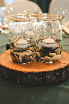 Mason Jar Centerpieces...I have the stones and we could buy the jars and twine and floater candles