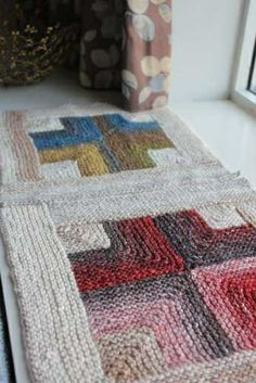 Wanna try ghis! The simplest edge-in mitred garter square, recolored and rotated: Mitered Crosses Blanket, knitting pattern to make with Noro yarn, from Mason-Dixon Knitting. Proceeds from pattern sales got to Japan relief..
