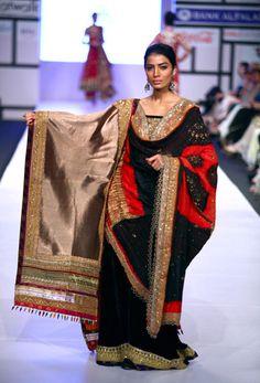 A Pakistani model presents a creation by Pakistani designer during Fashion Week, in Karachi. (Photo by Sohail Rafique)