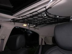 Mesh Bungee Net to hold mittens, hats, even coats on the ceiling of the van