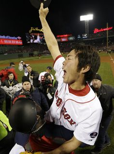 Boston Red Sox's David Ortiz carries relief pitcher Koji Uehara after winning Game 6 of baseball's World Series against the St. Louis Cardinals Wednesday, Oct. 30, 2013, in Boston. Uehara pitched the ninth with 1K (13-10).