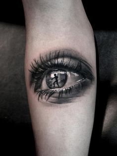 Realistic eye tattoo by Dionisis. Limited availability at Salvation Tattoo Studios.