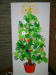 A really effective image, and it may be used on a fundraising Christmas card this year. Hand Christmas Tree, Handprint Christmas Tree, Preschool Christmas Crafts, Christmas Arts And Crafts, Kids Christmas, Christmas Door Decorating Contest, Christmas Door Decorations, Christmas Classroom Door, Murals For Kids