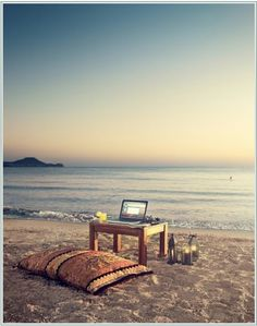Dream office on the beach with laptop and coushin what more do you need!