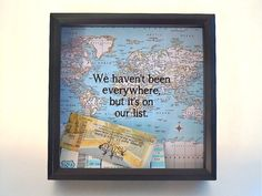 Drop your tickets in this great ticket display shadow box. This one features a map in the background and the words We havent been everywhere, but its on our list. The quote is printed on the map. **The photos show examples, but your ticket keeper box will feature a printed WORLD MAP. This ticket holder makes a wonderful display box for your tickets, photos, postcards, or anything else you want to keep and show off. The black 8x8 inch shadow box frame has a large slot at the top that makes…
