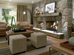 I'm so intimidated on how to decorate our huge fireplace...looks a lot like this one.  I love what they did with it!