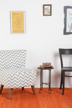 Ziggy Chair from Urban Outfitters...  though i would paint the wood legs a bright color to spruce it up.