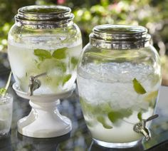 LOVE these classic Glass Drink Dispensers, especially the small one with the ceramic stand  {Pottery Barn}