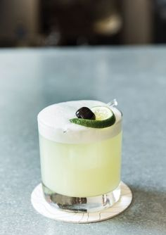 Green Eyes Gin Cocktail (Gin, lime juice, green Chartreuse, rich simple syrup, egg white. Garnish with cherry and slice of lime.