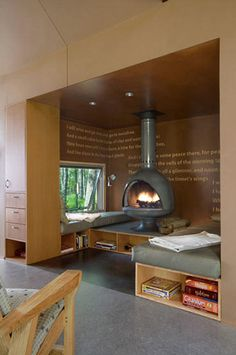 reading nook - (probably not in this house, but kinda neat), cozy to have a woodburning stove in the middle, and maybe like the idea of meaningful literary quotes scattered across the wall