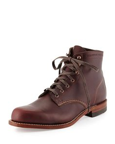 """Wolverine Cordovan 1000 Mile cowhide leather boot. Cap toe. Goodyear Welt construction. Stacked leather heel and outsole. Approximately 8""""H. 1"""" stacked heel. Made in USA."""