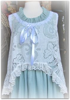 Beautiful crochet lace over top. Awesome layering piece.