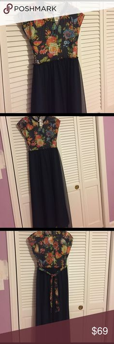 Beautiful maxi dress Floral top (see through) with a teal skirt and black over skirt with belt. Absolutely beautiful. Worn once but it does it doesn't fit. Tag says size small but it's pretty big. Measurements- waist 17' length 58' bust 17 1/2'. Please contact me for any more info :) Dresses Maxi