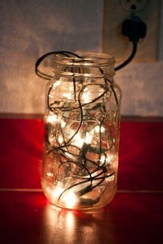 Fill a Mason Jar With Christmas Lights. Dangerous. The lights emit heat, which will very soon melt the plastic of the wires leading to a short circuit. Pretty. But not worth the risk!