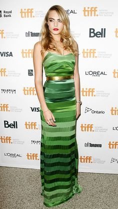 Cara Delevingne keeps it cool in a green striped gown. // #Celebrity