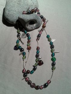 Long wrap around beaded charm necklace. by DitsyDaisyUK on Etsy, £15.00